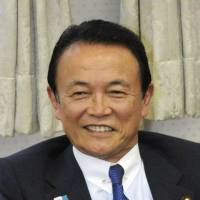 Aso keeps beating drum for tax hike