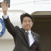 Staying in the spotlight: Prime Minister Shinzo Abe heads to Southeast Asia on Thursday from Haneda airport. | KYODO