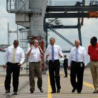 Pageantry and salesmanship: U.S. President Barack Obama (center) tours the port of Jacksonville, Florida, on  Thursday. | AP