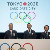 Game on: Key promoters of Tokyo's 2020 Olympics bid (from center to right) Japanese Olympic Committee President Tsunekazu Takeda, Deputy Prime Minister and Finance Minister Taro Aso and Tokyo Gov. Naoki Inose make a presentation Wednesday during the first day of the International Olympic Committee's extraordinary session in Lausanne, Switzerland. | AP