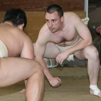 Head to head: Nagoya University sumo club member Alexandre Tonitti from Switzerland takes part in a practice at the school. | CHUNICHI SHIMBUN