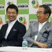 Strange bedfellows: Nippon Ishin no Kai co-leaders Toru Hashimoto (left) and Shintaro Ishihara chat during a July 2 meeting in Tokyo of the party's Diet members. | KYODO