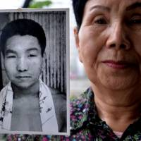 Ordeal unending: Hideko Hakamada, whose younger brother, ex-boxer Iwao Hakamada, has been on death row for 47 years, shows a picture of him during a May 20 interview in Tokyo. | AFP-JIJI