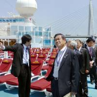 Smooth sailing?: Officials from the Osaka Municipal Government and Osaka Chamber of Commerce and Industry tour the cruise ship Diamond Princess on May 8. | KYODO