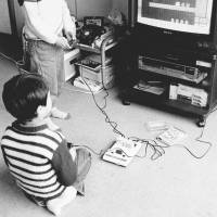 Game changer: Children play a 'Famicom' game console linked to a TV in 1986. | KYODO