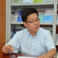 Optimistic: Yang Bojiang, deputy director of the Institute of Japanese Studies at the Chinese Academy of Social Sciences, is interviewed last Friday in Beijing. | KYODO