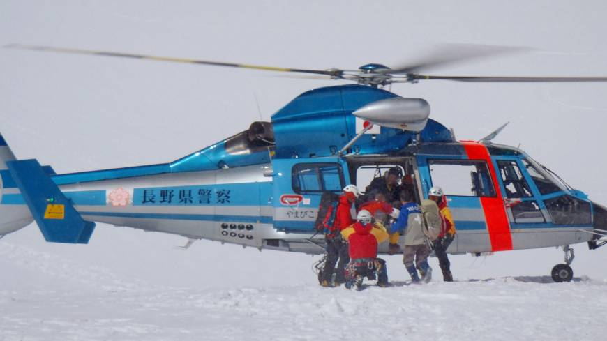 A rescue team airlifts an accident victim in the Hotaka Mountain Range in the Northern Alps in May.