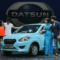 Artistic license: Indian artists pose with the newly launched Datsun GO after a performance in New Delhi on Monday. | AP