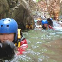 Go with the flow: Participants enjoy canyoning in the Anogawa River in Minakami, Gunma Prefecture, on June 10. | KYODO