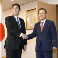 Kishida, Kim try to patch up ties
