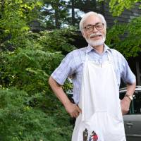 A dream takes flight: Director Hayao Miyazaki stands in front of his studio in Koganei, Tokyo, earlier his month ahead of the release of his latest movie, 'Kaze Tachinu' ('The Wind Rises'), this Saturday. | KYODO