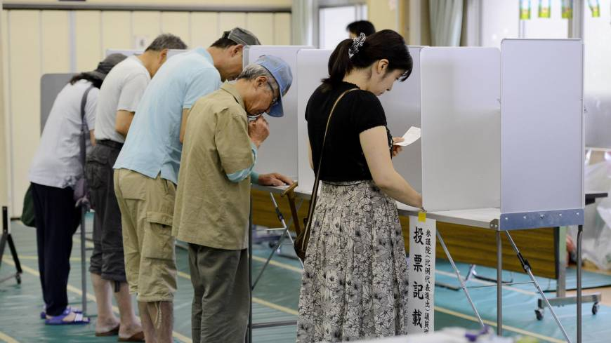 Just the ticket: Voters fill out their ballots for the House of Councilors election on Sunday in Minato Ward, Tokyo.
