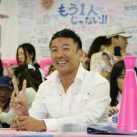V for victory: Actor Taro Yamamoto celebrates Sunday evening at his campaign office in Tokyo after his victory in the Upper House election was assured. | KYODO