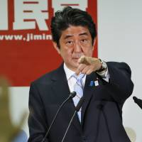 Questions and answers: Prime Minister Shinzo Abe points at a reporter during a news conference in Tokyo on Monday after his Liberal Democratic Party cruised to a comfortable victory in the House of Councilors election. | AP