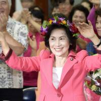 Joyous: Keiko Itokazu, chairwoman of a local party in Okinawa, dances to traditional Okinawan music after winning in the Upper House election on Sunday. | KYODO