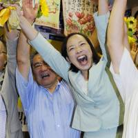 While Yoshiko Kira of the Japanese Communist Party celebrates her win in the same district on Sunday night. | KYODO