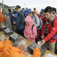 Mount Fuji fee charged, but signs in Japanese