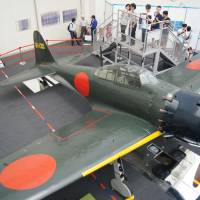 Zeke peek: A Zero Fighter Type 52, on loan from a U.S. museum, is the hottest display at Tokorozawa Aviation Museum in Tokorozawa, Saitama Prefecture. Thanks to the recent release of Hayao Miyazaki's animated film 'Kaze Tachinu' ('The Wind Rises'), visitors here tripled in June compared with the previous year, and more are expected this summer. | KYODO