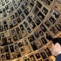 Testimony: Foreign Minister Fumio Kishida tours the Hall of Names at the Yad Vashem Holocaust Museum in Jerusalem on Wednesday. | AFP-JIJI
