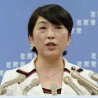 Quitting the helm: Mizuho Fukushima attends a press conference after her resignation was accepted at the party executive meeting Thursday. | KYODO