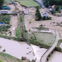 Expect delays: A Japan Railway Yamaguchi Line bridge is washed out Monday by a deluge-swollen river in the city of Yamaguchi. | KYODO