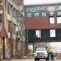 Closing up shop: A dilapidated factory stands in Detroit in 2012. The city has racked up debts of $19 billion.   | KYODO