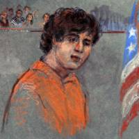 In the open: Accused Boston bomber Dzhokhar Tsarnaev makes his first court appearance Wednesday.  | AP