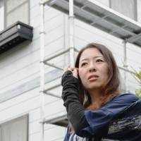 Discouraged: Keiko Fujinami, a housewife forced out of her home in Naraha, Fukushima Prefecture, is afraid nothing will change after the Upper House election. | KYODO