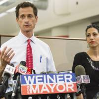 Major boner: New York mayoral candidate Anthony Weiner holds a news conference with his wife, Huma Abedin, in the Big Apple on  Tuesday after a website revealed another batch of explicit communications between the Democrat and a young woman.  | AP