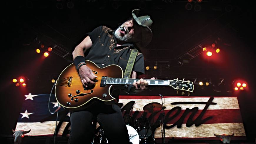 Rocking out: Ted Nugent performs in Roanoke, Virginia, on April 28 during a tour with Styx and REO Speedwagon.