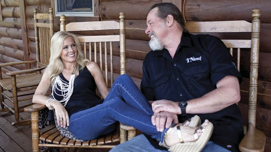 No foolin' around: Ted Nugent and his wife, Shemane, relax on their 470 hectare ranch in Concord, Michigan, on June 6. Ted, 64, said when he was younger he spent his money buying hunting property instead of drugs, like many of the musicians in his time did. Their main ranch is in Texas, but they spend time in Michigan throughout the year.