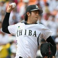 High powered: Chiba Lotte pitcher Yuta Omine delivers during the Marines' 11-3 win over the Hawks on Sunday. | KYODO