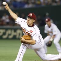 Dynamic effort: Eagles right-hander Masahiro Tanaka tosses a four-hit shutout against the Fighters on Tuesday at Tokyo Dome. | TOHOKU RAKUTEN BEAT HOKKAIDO NIPPON HAM 5-0.