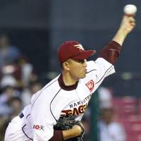 Complete focus: Eagles southpaw Takashi Kawai fires a pitch at Kleenex Stadium on Thursday night. Kawai tossed seven scoreless innings as Tohoku Rakuten defeated the Hokkaido Nippon Ham Fighters 3-0. | KYODO