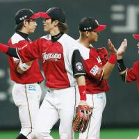 On the attack: The Hokkaido Nippon Ham Fighters celebrate their 14-3 win over the Seibu Lions on Monday. | KYODO