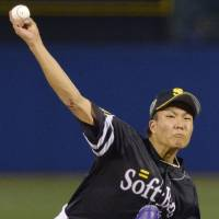 Impressive outing: Hawks right-hander Kodai Senga, seen firing a pitch to a Central League batter, struck out five batters in two innings of work on Saturday in Game 2 of the All-Star Series at Jingu Stadium. | KYODO