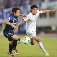 Second coming: Akira Kaji (left) helped Gamba Osaka top the J2 table at the halfway point of the season. | KYODO