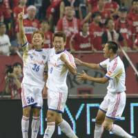 First things first: FC Tokyo's Hirotaka Mita, 36, celebrates with his teammates after scoring the opening goal against Urawa on Wednesday. The match ended in a 2-2 draw. | KYODO