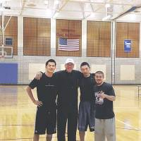 Reunion: Former Tokyo Apache players (left to right) Jumpei Nakama, Minoru Kimura and Cohey Aoki pose with ex-coach Bob Hill at Trinity University in San Antonio. | COURTESY PHOTO