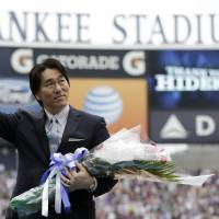Signing off: Former Yankees slugger Hideki Matsui waves to the crowd at Yankee Stadium during his retirement ceremony on Sunday in New York. | AP