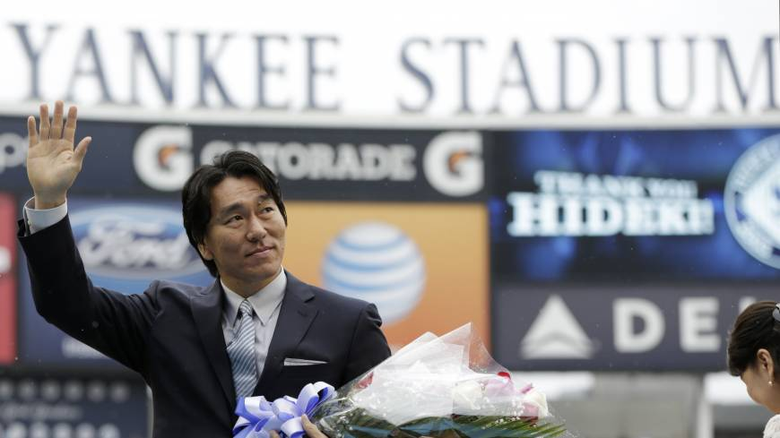 Signing off: Former Yankees slugger Hideki Matsui waves to the crowd at Yankee Stadium during his retirement ceremony on Sunday in New York.