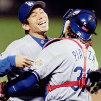 The Warrior: Hideo Nomo is hugged by Dodgers catcher Mike Piazza after thowing a no-hitter at Coors Field in 1996. | KYODO