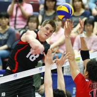 Like a hammer: Canada's John Gordon Perrin spikes the ball against Japan in their FIVB World League match on Saturday afternoon in Osaka. Canada won the four-set Group C match. | FIVB