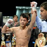 Still the champion: Koki Kameda retains his WBA bantamweight title, beating John Mark Apolinario on Tuesday at Tokyo Big Sight. | KYODO