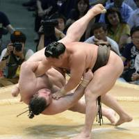 Rolling along: Yokozuna Hakuho collects his 35th consecutive victory on Thursday, overpowering Gagamaru in the raised ring at the Nagoya Grand Sumo Tournament. | KYODO