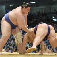 Staying aggressive: Bulgarian maegashira Aoiyama manhandles Chiyotairyu on the 12th day of the Nagoya Grand Sumo Tournament. With a win on Thursday, Aoiyama improved to 10-2. | KYODO