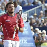Painful exit: Stan Wawrinka grimaces with back pain in his quarterfinal match against Feliciano Lopez at the Swiss Open on Friday. Lopez led 6-4, 2-6, 4-3 when Wawrinka retired in the final set. | AP