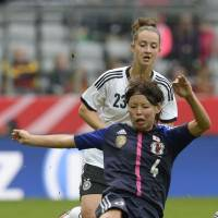 Familiar result: Saki Kumagai (front) and Germany's Sara Daebritz vie for the ball during a friendly on Saturday in Munich. Germany won the match 4-2. | AFP-JIJI