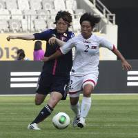 Going after it: North Korea's Choe Un Ju (right) competes for the ball against Japan's Mizuho Sakaguchi during their Women's East Asian Cup match in Hwaseong, South Korea, on Thursday. | AP