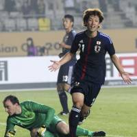 Osako bags pair as Japan edges Australia